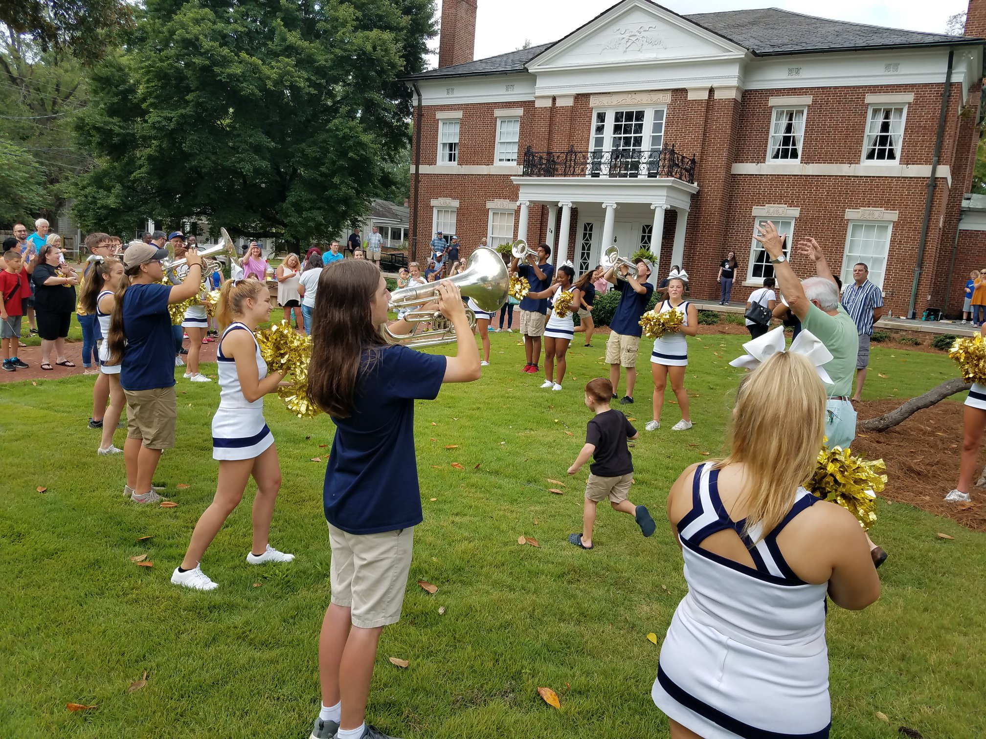 A pep rally outside in front of Newnan-Coweta Historical Society