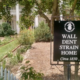 """An historical marker, that reads """"Wall Dent Strain Home Circa 1850, is pictured in front of a home in the Newnan-Coweta county."""