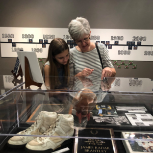 Museum patrons look at artifacts.
